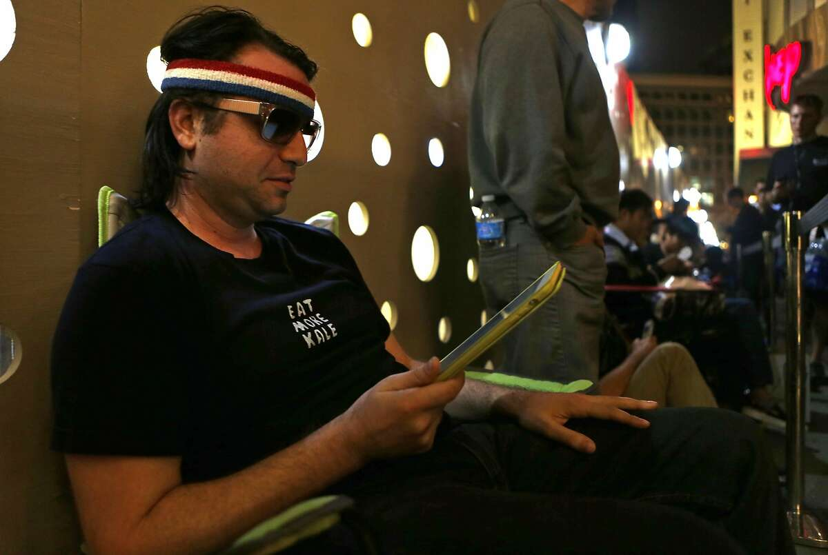 Josh Bell of San Francisco is among 100 people waiting in line at 9pm on Thursday, September 17, 2014 at the Apple Store on Stockton Street in San Francisco, Calif., to buy the new iPhone 6 that will go on sale Friday morning.