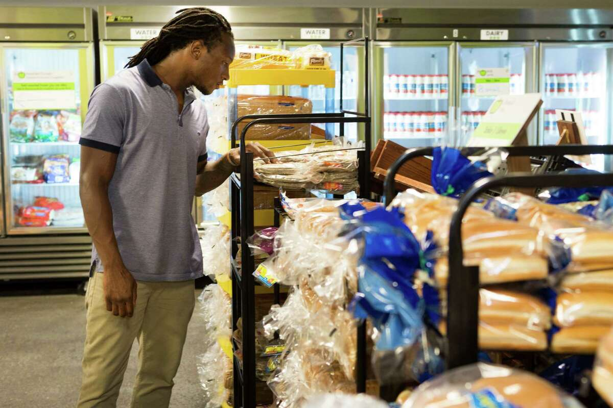 Houston Texans wide receiver DeAndre Hopkins browses through the items in the emergency food pantry at the Houston Food Bank on Tuesday, Sept. 16, 2014, in Houston. Hopkins will serve as an ambassador and spokesman for the Houston Food Bank and Souper Bowl of Caring in 2014. Hopkins hopes to raise awareness about hunger and help bring about hunger relief throughout the Houston community through volunteer activities, appearances and nutrition education.