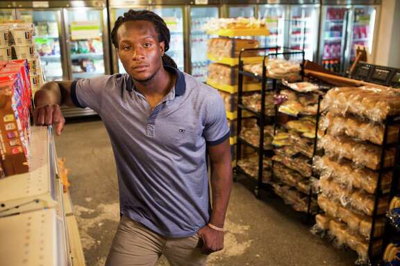 Houston Texans wide receiver DeAndre Hopkins poses for a portrait in the emergency food pantry at the Houston Food Bank on Tuesday, Sept. 16, 2014, in Houston. Hopkins will serve as an ambassador and spokesman for the Houston Food Bank and Souper Bowl of Caring in 2014. Hopkins hopes to raise awareness about hunger and help bring about hunger relief throughout the Houston community through volunteer activities, appearances and nutrition education.