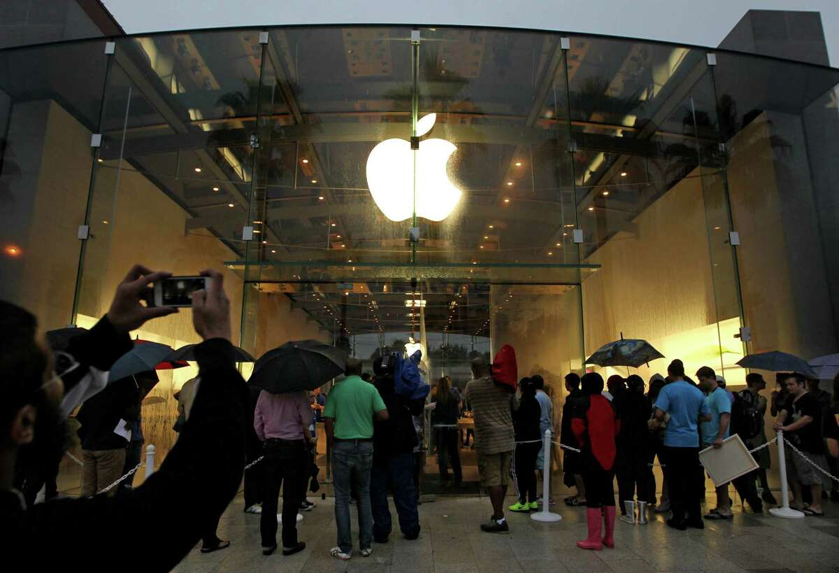 Customers line up just before the doors open to release Apple's iPhone 6 and iPhone 6 Plus at the Apple Store in Highland Village 4012 Westheimer Road Friday, Sept. 19, 2014, in Houston, Texas.