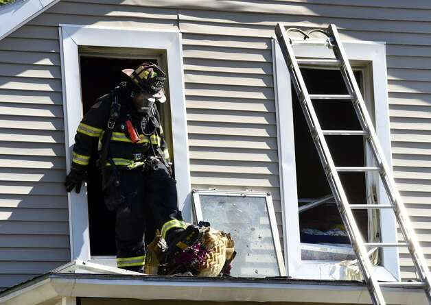 Firefighting teams from Rensselear and mutual aid companies work a fire at 1808 4th Street in Rensselaer. (Skip Dickstein/Timies Union)