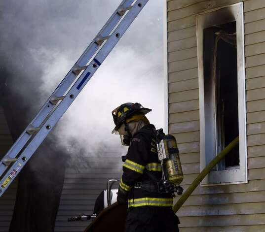 A firefighter works a fire at 1808 4th Street in Rensselaer. (Skip Dickstein/Timies Union)