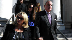 Former Governor John Rowland and his wife Patty leave the Federal Courthouse in New Haven, Conn., Sept. 19, 2014 after a jury found him guilty on all counts.