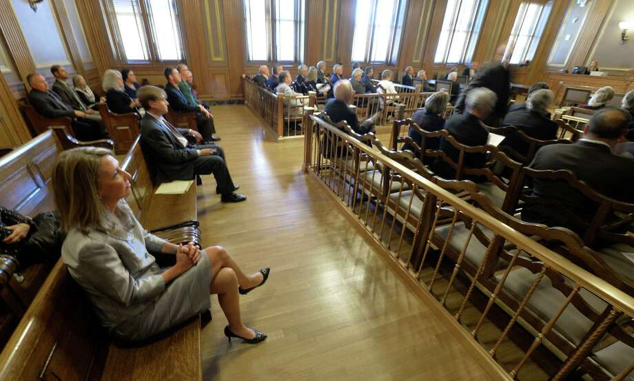 Attorney Lisa Fisher sits in the back of the court room on the second floor of the Albany County Courthouse and waits to hear the results of the GOP nominating committee for Supreme Court Judge Friday afternoon Sept. 19, 2014,  in Albany, N.Y.     (Skip Dickstein/Times Union) Photo: SKIP DICKSTEIN / 00028696A