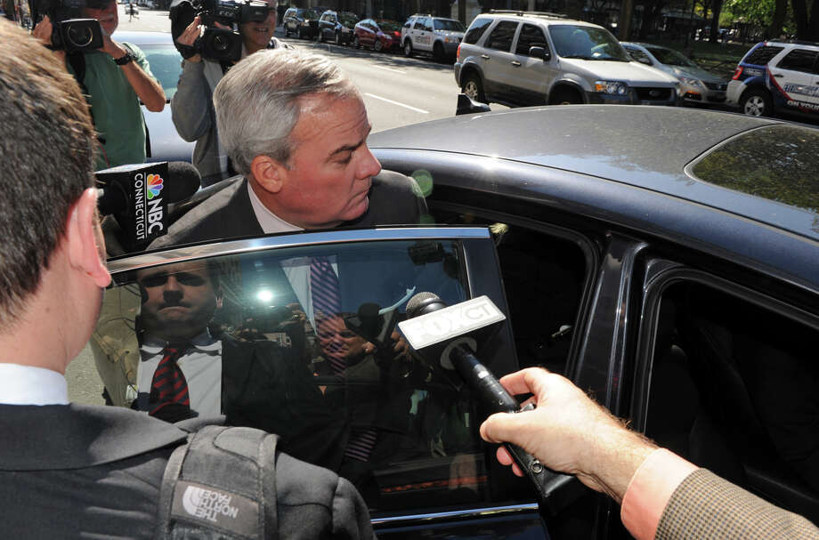 Former Gov. John G. Rowland leaves the Federal Courthouse after his trial in New Haven, Conn., on Friday Sept. 19, 2014. Rowland was found guilty on all seven federal counts of violating campaign laws. Photo: Christian Abraham / Connecticut Post