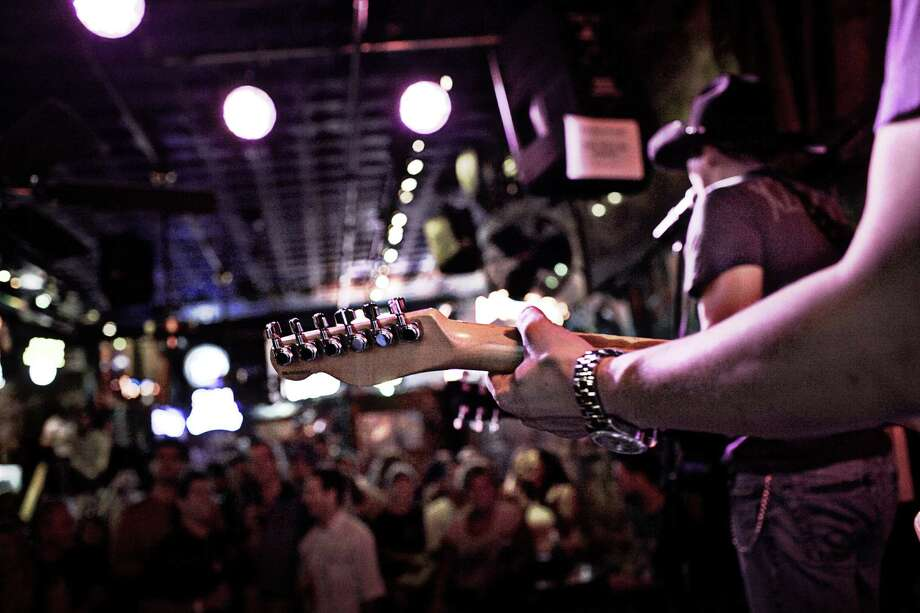 Honky tonks and country-western bars can be found all over Nashville but dominate the city's downtown Music District.  (photo courtesy of Nashville Convention & Visitors Corporation) Photo: Nashville Convention & Visitors / ©2008 Wolf Hoffmann