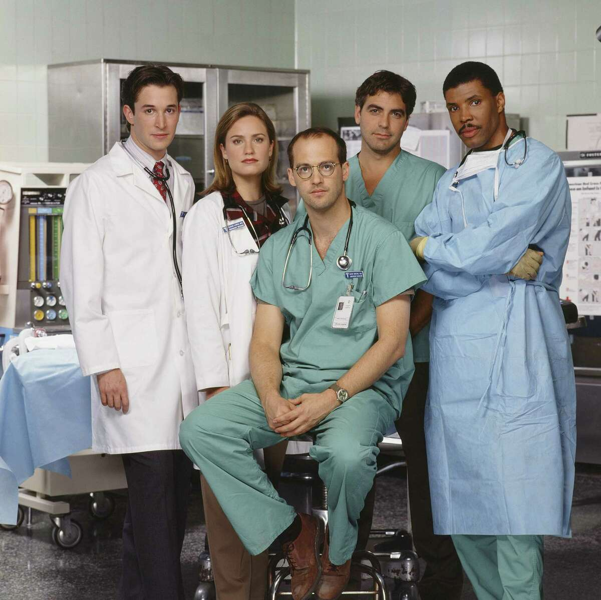 """""""ER"""" debuted on NBC on Sept. 19, 1994, ushering in one of the most popular medical dramas in TV history. Here's a look at what the cast is up to now, in honor of the 20th anniversary of """"ER's"""" premiere. Pictured from Season 1 (l-r): Noah Wyle as Dr. John Carter; Sherry Stringfield as Dr. Susan Lewis; Anthony Edwards as Dr. Mark Greene; George Clooney as Dr. Doug Ross; and Eriq La Salle as Dr. Peter Benton."""