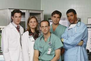 ER -- SEASON 1 -- Pictured: (l-r) Noah Wyle as Doctor John Carter; Sherry Stringfield as Doctor Susan Lewis; Anthony Edwards as Doctor Mark Greene; George Clooney as Doctor Doug Ross; Eriq La Salle as Doctor Peter Benton -- Photo by: NBCU Photo Bank
