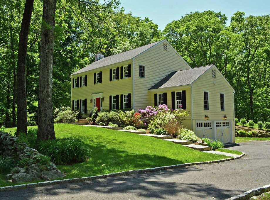 This classic Colonial located at 292 Briscoe Road sits on 4 acres in New Canaan and is on the market for 1,596,000. Photo: Contributed Photo, Contributed / New Canaan News Contributed