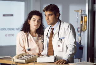 ER -- Season 1 -- Pictured: (l-r) Julianna Margulies as Nurse Carol Hathaway, George Clooney as Doctor Doug Ross -- Photo by: NBCU Photo Bank 2008
