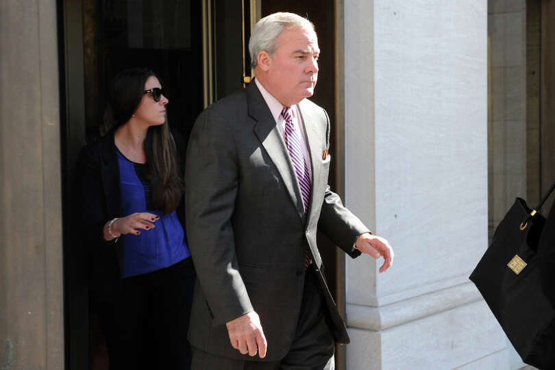 Former Gov. John G. Rowland leaves the Federal Courthouse in New Haven, Conn. Sept. 19, 2014. A jury