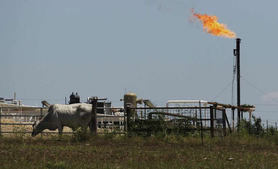 The explosion of oil and gas production on the Eagle Ford Shale is an economic boon, but it also has spawned air quality and road challenges that must be addressed. Photo: Kin Man Hui / San Antonio Express-News / ©2014 San Antonio Express-News