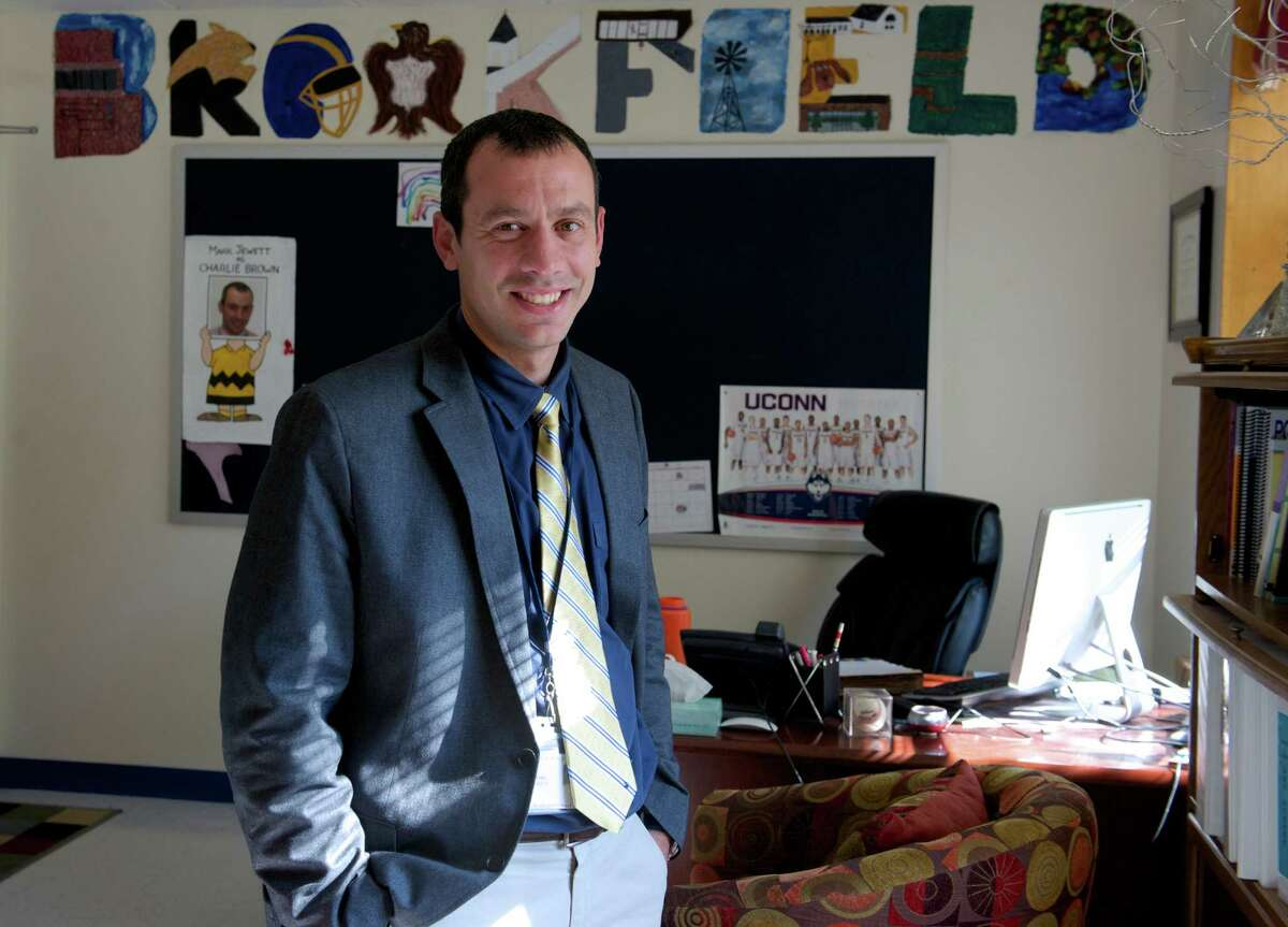 Mark Jewett, 36, the interim Principal of Brookfield High School, in his office on Friday, September 19, 2014, in Brookfield, Conn.