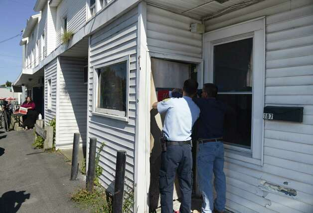 Code enforcement officials from the Town of Colonie post notice that the building at 470 Troy-Schenectady Road is closed to occupancy Friday afternoon, Sept. 19, 2014, in Colonie, N.Y.  The violations include structural, electric and plumbing issues. There are apartments on the second floor where seven to 10 tenants live. The first floor features One Step Beauty Shop and day-labor provider. The building is owned by Kim Kee Chun, who also owns the neighboring Ala Shanghai Chinese Cuisine restaurant. (Will Waldron/Times Union) Photo: WW / 00028702A