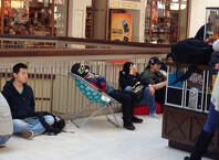 People line up near the Apple Store at the Danbury Fair Mall to purchase the new iPhone 6 and 6+ Friday morning, Sept. 19, 2014.
