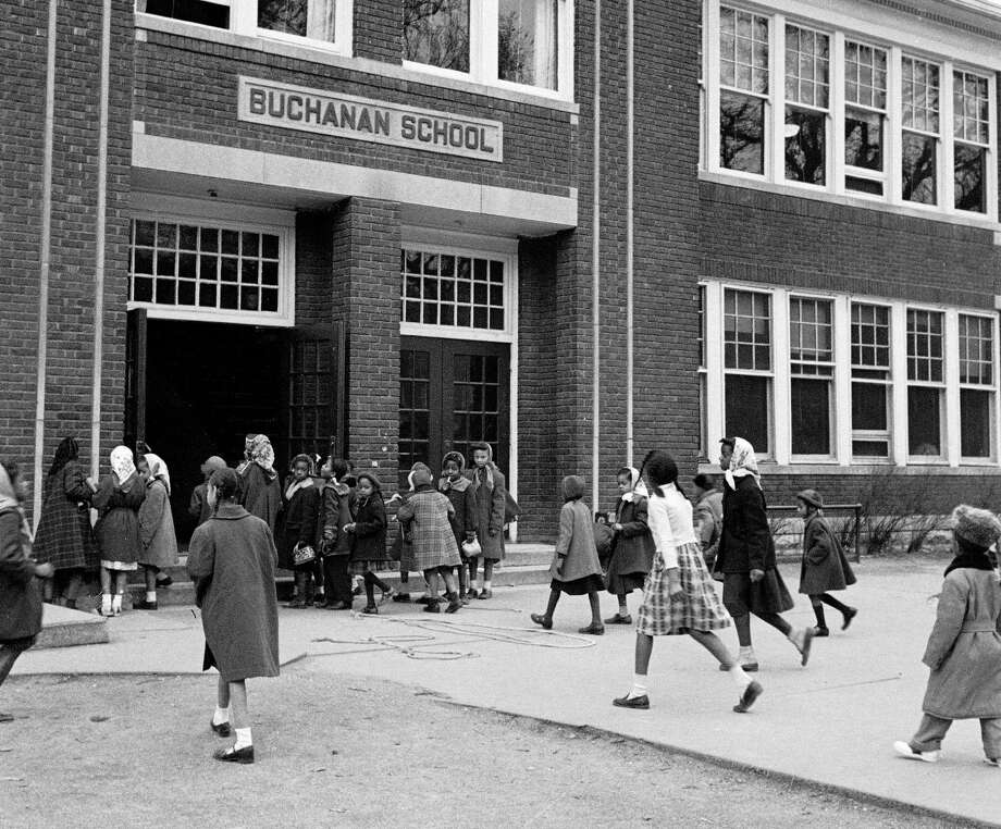 A 1953 photo of African American children arriving for class at the segregated Buchanan Elementary School in Topeka, Kansas prompting the famed legal suit of Brown vs. Board of Education. Photo: Carl Iwasaki, Carl Iwasaki/The LIFE Images Col / Carl Iwasaki  (Photo by Carl Iwasaki/The LIFE Images Collection/Getty Images) GettyGetty