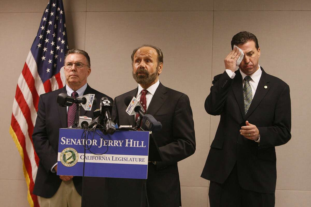 Flanked by Assemblyman Kevin Mullin (left) and San Bruno Mayor Jim Ruane, State Senator Jerry Hill calls for an investigation of communications between Pacific Gas and Electric Co. and the California Public Utilities Commission during a press event outside the state attorney general's office in San Francisco on Friday, September 19, 2014.