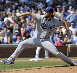 The Dodgers' Clayton Kershaw pitched five shaky innings but got his 20th win in his shortest start in 3 1/2  months.