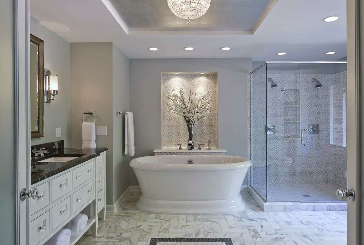 Free-standing tubs are among the top trends for bathrooms in 2014. This design from the National Kitchen & Bath Association plays to other trends, including whites and grays, and tile flooring. Homeowners also want easy accessibility and lots of light.