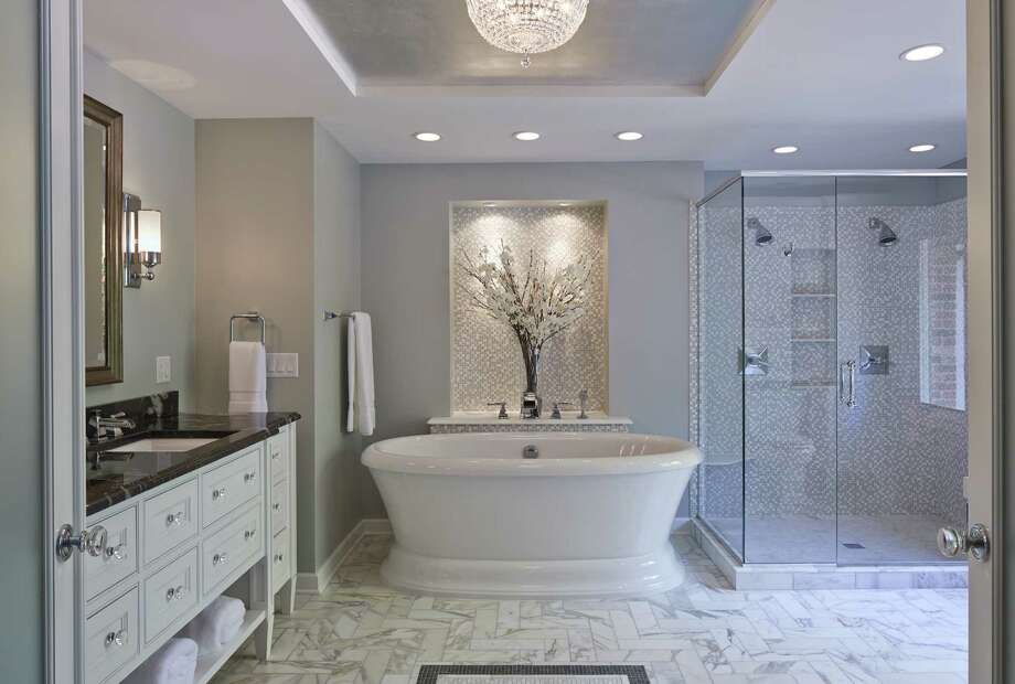 Free-standing tubs are among the top trends for bathrooms in 2014. This design from the National Kitchen & Bath Association plays to other trends, including whites and grays, and tile flooring. Homeowners also want easy accessibility and lots of light. Photo: National Kitchen & Bath Association Photos / San Antonio Express-News