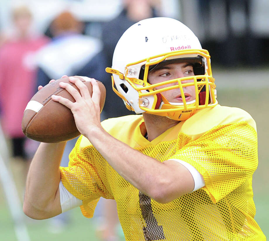 Brunswick School quarterback Billy O'Malley (#1) throws during the high school football scrimmage between Brunswick School and Cheshire Academyl at Brunswick in Greenwich, Conn., Saturday, Sept. 13, 2014. Photo: Bob Luckey / Greenwich Time