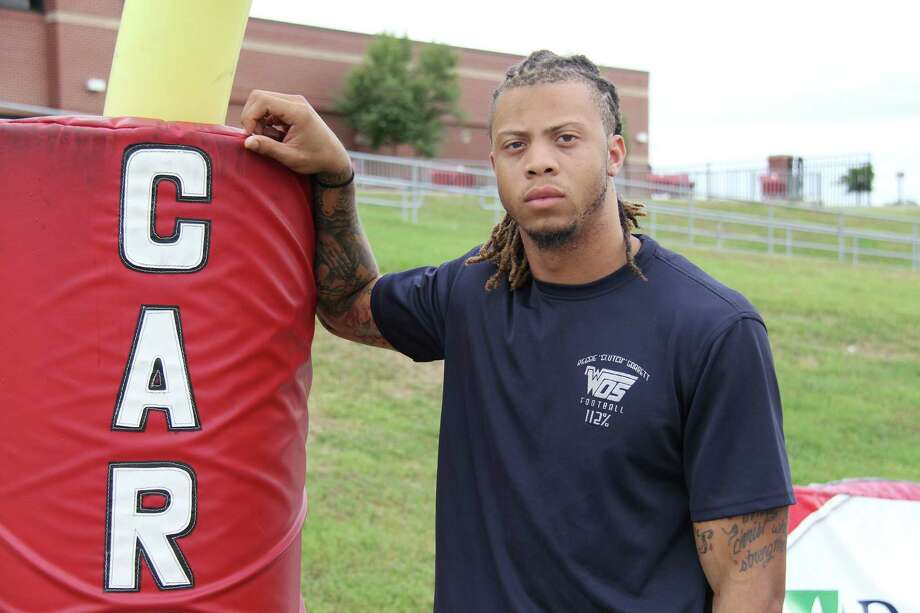 Former West Orange-Stark star Mark Roberts wears a shirt bearing the name of his former teammate, Reggie Garrett. Garrett died during a football game four years ago on Sept. 17, 2010. Photo provided by Lamar University
