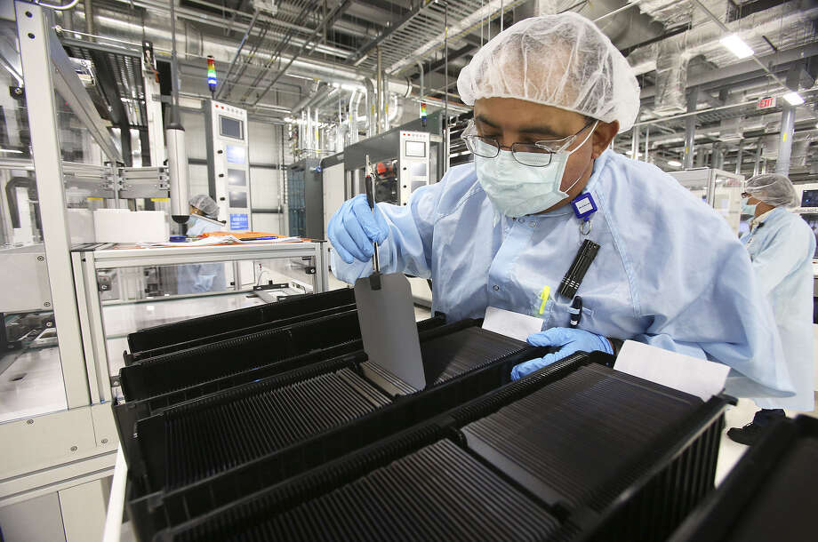 Lawrence Gutierrez organizes wafers mid way in the production process.