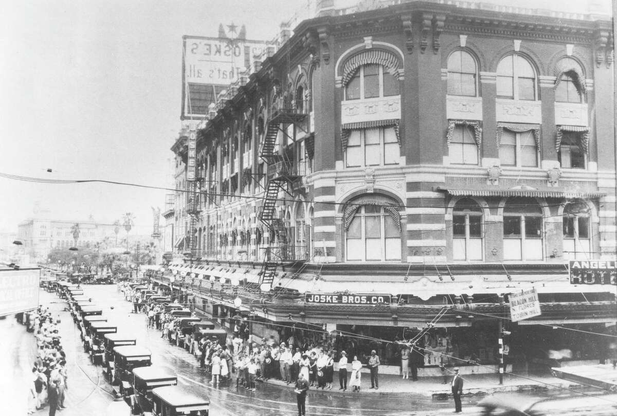 Joske Bros. store at Alamo and Commerce streets is shown on July 10, 1925, as owner Alexander Joske's funeral procession passes by.