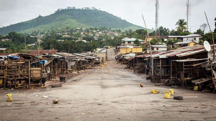 An empty local market area is seen, as Sierra Leone government enforces a three day lock-down on movement of all people in a attempt to fight the Ebola virus, in Freetown, Sierra Leone, Friday, Sept. 19, 2014. Thousands of health workers began knocking on doors across Sierra Leone on Friday in search of hidden Ebola cases with the entire West African nation locked down in their homes for three days in an unprecedented effort to combat the deadly disease. (AP Photo/ Michael Duff) Photo: Michael Duff, STR / AP