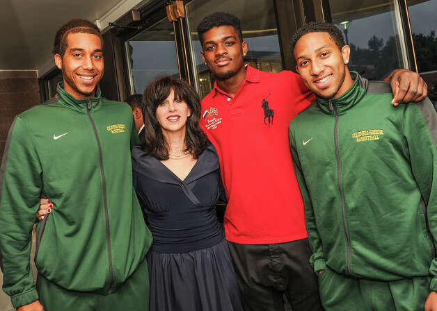 Columbia-Greene Community Foundation Executive Director Joan Koweek, second from left, gathers with Columbia-Greene Community College students and basketball team members, from left, Rodney Dickson, Nate Williams and Derwyn Thompson, during the Columbia-Greene Community Foundation?s gala fundraiser, held the night of Sept. 13 at the Greenport campus. (Submitted photo)