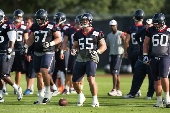 Houston Texans offensive linemen Derek Newton (75), Cody White (67), Chris Myers (55) and Ben Jones (60) walk up to the line to run a play during Texans training camp at the Methodist Training Center Saturday, July 26, 2014, in Houston.  ( Brett Coomer / Houston Chronicle )