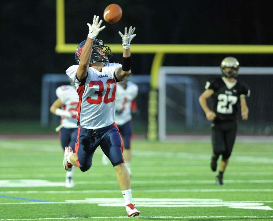 New Fairfield tight end Gregory Radovic extends his arms attempting a catch in the high school football game between Joel Barlow and New Fairfield at Joel Barlow High School in Redding, Conn. Friday, Sept. 19, 2014. Photo: Tyler Sizemore / The News-Times