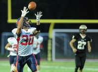 New Fairfield tight end Gregory Radovic extends his arms attempting a catch in the high school football game between Joel Barlow and New Fairfield at Joel Barlow High School in Redding, Conn. Friday, Sept. 19, 2014.
