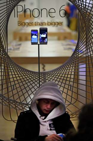 This customer how the fatigue while waiting the long hours on line to receive his new IPhone 6 Friday morning Sept 19, 2014 at the Apple Store in Crossgates Mall in Albany, N.Y.     (Skip Dickstein/Times Union) Photo: SKIP DICKSTEIN / 00028688A