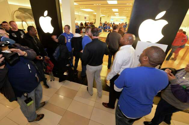 The door opened and some the approximately 500 shoppers entered the store to receive their new IPhone 6 Friday morning Sept 19, 2014 at the Apple Store in Crossgates Mall in Albany, N.Y.     (Skip Dickstein/Times Union) Photo: SKIP DICKSTEIN / 00028688A