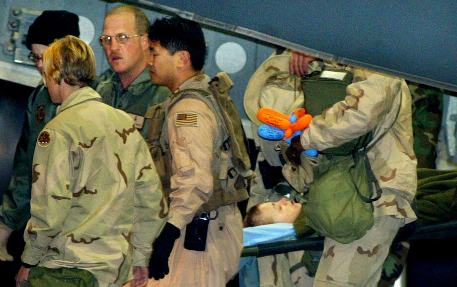 As an Army private first class, Jessica Lynch is carried on a stretcher off a C-17 military plane at the U.S. air base in Ramstein, southern Germany, in April 2003. She was rescued by U.S. special forces more than a week after she and other members of her unit were captured in Iraq. Photo: Associated Press File Photos / AP