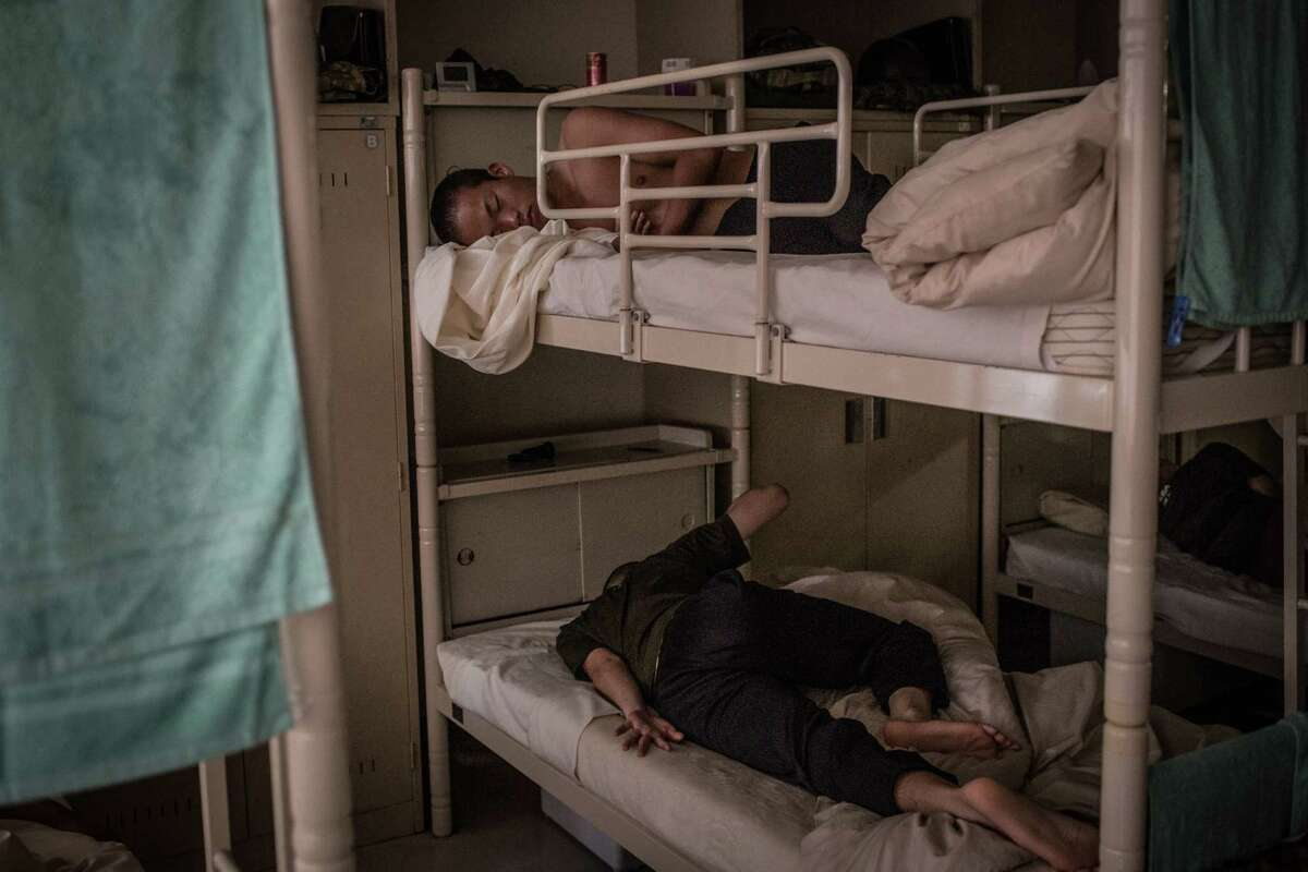 Students sleep in a dormitory at the Japan Ground Self-Defense Force (JGSDF) High Technical School on September 17, 2014 in Yokosuka, Japan.
