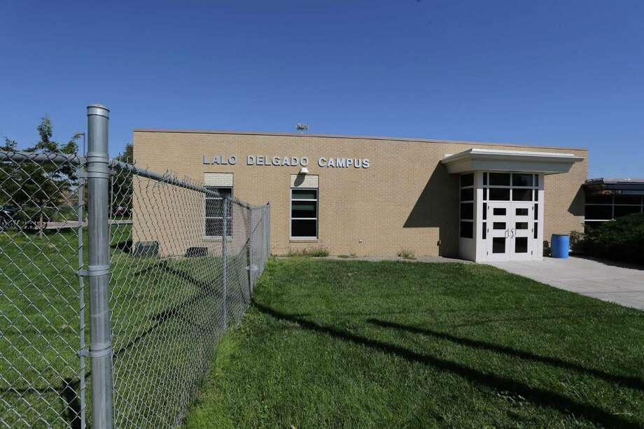 This Friday, Sept. 19, 2014 photo shows the exterior of the Lalo Delgado school campus in Denver.   Four students were injured, one seriously, when a teacher was pouring methanol onto a table top and igniting it during a chemistry class demonstration last Monday.  Educators and investigators say some teachers lack the training required by law and don't know about standard safety measures that can dramatically lower the inherent dangers of hands-on experiments  they say are vital to science education. (AP Photo/Brennan Linsley)  ORG XMIT: COBL101 Photo: Brennan Linsley / AP