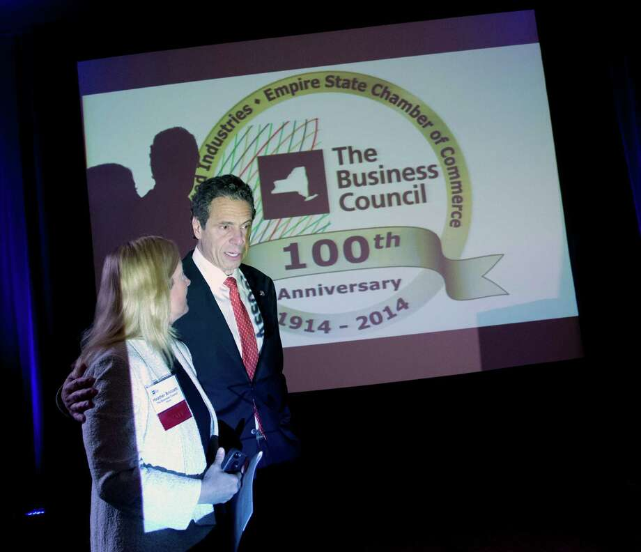 New York Gov. Andrew Cuomo, right, arrives to speak at the annual meeting of the Business Council of New York State with Heather Briccetti, president of the business council, at the Sagamore Resort on Friday, Sept. 19, 2014, in Bolton Landing, N.Y. (AP Photo/Mike Groll) ORG XMIT: NYMG106 Photo: Mike Groll / AP