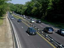 Traffic passes by a construction zone on the Merritt Parkway near the Newfield Avenue overpass in Stamford, Conn., on Friday, September 19, 2014.