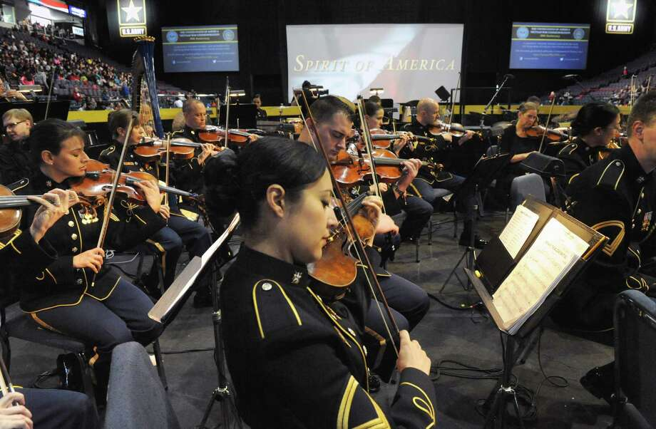 Violinist Sgt. 1st Class Marlisa Woods warms up with other members of the U.S. Army Band before  the Spirit of America Show at the Times Union Center on Friday Sept. 19, 2014 in Albany, N.Y. History comes to life during this free, patriotic, live-action show on September 19-20 at the Times Union Center that tells the history of our nation through the eyes of the American Soldier.  (Michael P. Farrell/Times Union) Photo: Michael P. Farrell / 00028423A