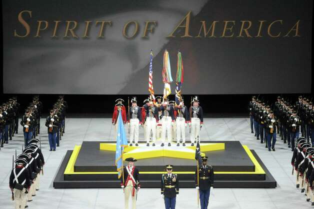 The U.S. Color Guard opens the Spirit of America Show at the Times Union Center on Friday Sept. 19, 2014 in Albany, N.Y. History comes to life during this free, patriotic, live-action show on September 19-20 at the Times Union Center that tells the history of our nation through the eyes of the American Soldier.  (Michael P. Farrell/Times Union) Photo: Michael P. Farrell / 00028423A