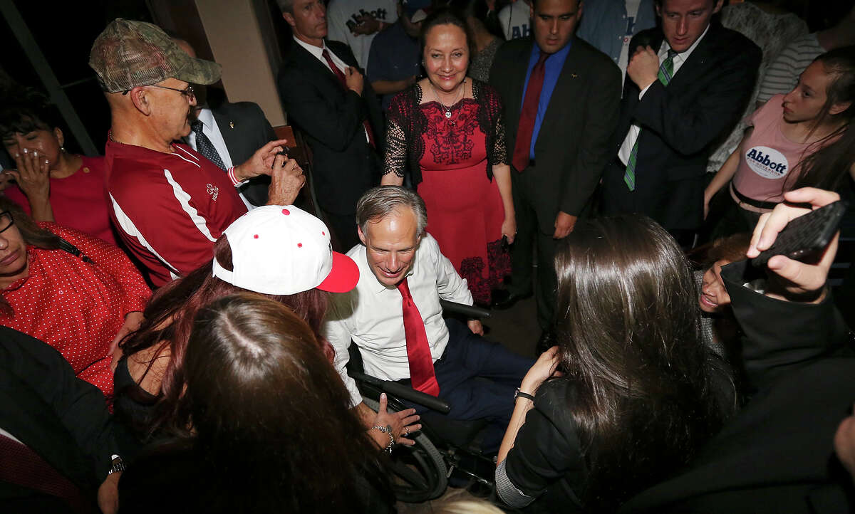 Texas Attorney General Greg Abbott talks with supporters, at Buffalo Wings & Rings, after the gubernatorial debate with Texas State Sen. Wendy Davis (not pictured) Friday Sept. 19, 2014 in Edinburg, Tx.