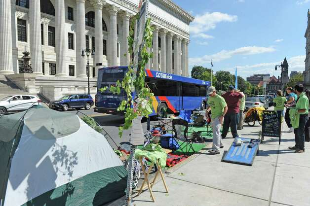 The staff of Parks & Trails New York set up a temporary camp site as part of Park(ing) Day in a parking spot on Washington Avenue on Friday Sept. 19, 2014 in Albany, N.Y.  (Michael P. Farrell/Times Union) Photo: Michael P. Farrell / 00028661A