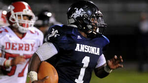 Ansonia QB JaiQuan McKnight carries the ball, during high school football action against Derby in Ansonia, Conn., on Friday Sept. 19, 2014.