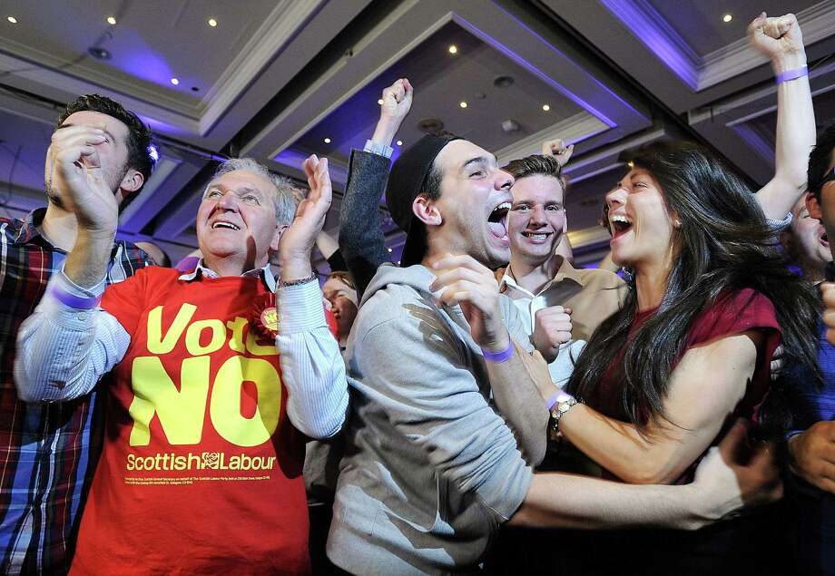 Pro-union supporters celebrate as Scottish independence referendum results are announced at a 'Better Together' event in Glasgow, Scotland, onFriday. Photo: ANDY BUCHANAN, Stringer / © Andy Buchanan 2014 All Rights Reserved.