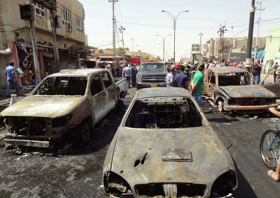 A motorcycle bombing near a gun shop in Kirkuk in northern Iraq on Friday killed 10 people. Photo: Marwan Ibrahim / Getty Images / AFP
