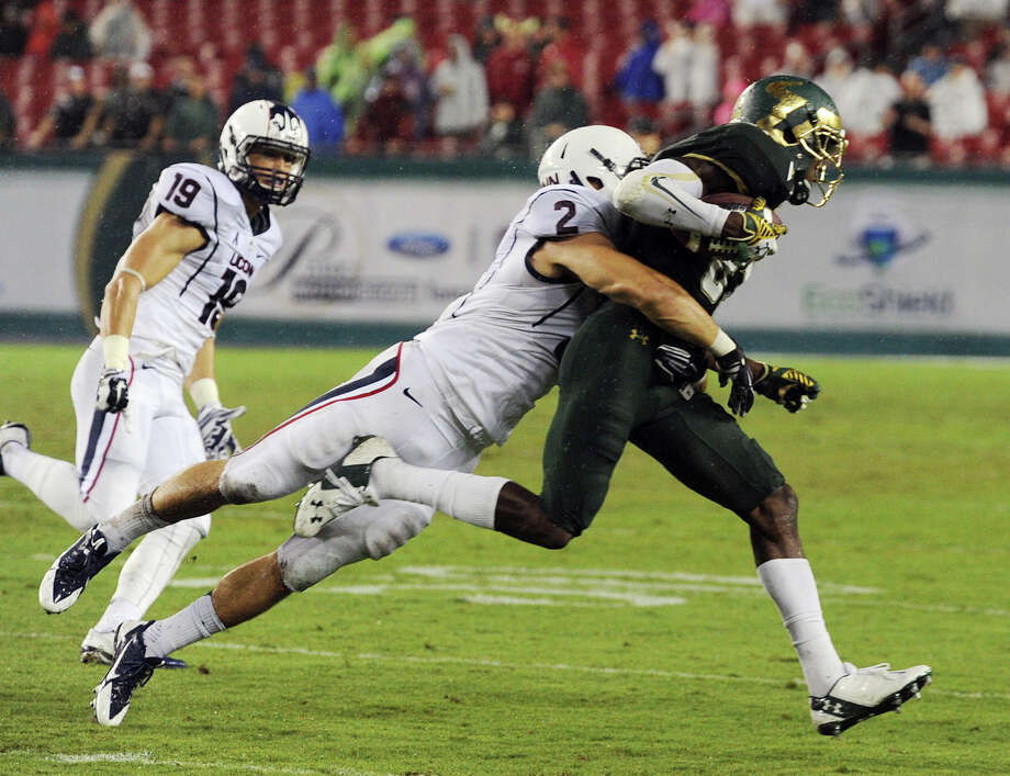 University of South Florida's Rodney Adams (87) runs against UConn, during a football game, Friday, Sept. 19, 2014 at Raymond James Stadium in Tampa, Fla. (AP Photo/Tampa Tribune, Andy Jones)  ST. PETERSBURG OUT; LAKELAND OUT; BRADENTON OUT; MAGS OUT; LOCAL TELEVISION OUT; WTSP CH 10 OUT; WFTS CH 28 OUT; WTVT CH 13 OUT; BAYNEWS 9 OUT; THE TAMPA BAY TIMES OUT; LAKELAND LEDGER OUT; BRADENTON HERALD OUT; SARASOTA HERALD-TRIBUNE OUT; WINTER HAVEN NEWS CHIEF OUT Photo: Andy Jones, AP / Associated Press