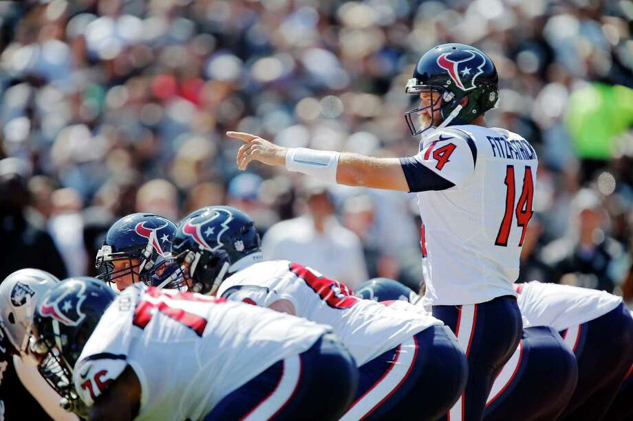 Quarterback Ryan Fitzpatrick's 10 years of experience helps keep him calm during pressure-packed third downs to help the Texans move the chains. Photo: Brian Bahr, Stringer / 2014 Getty Images