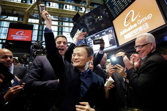 Jack Ma of Alibaba raises a mallet before striking a bell Friday at the New York Stock Exchange.